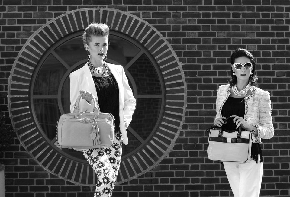 On Bethany (left): Marc Cain print pants, $318; Athena earrings, $78; both Jones & Jones. Rag & Bone blazer, Ruth Shaw, $795. Avec fringe top, Lori K, $110. Isabelle Fiore bag, urbanminx.com, $350. Rococo Rocks necklace, Bijoux Inspired Jewels, $460. On Anna: Theory pants, $220, and fringe top, $325; Alice + Olivia tweed jacket, $495; all L'Apparenza. Kate Spade purse, $318; Prada glasses, $475; both Handbags in the City. Pearl earrings, Jones & Jones, $98. Rococo Rocks necklace, Bijoux Inspired Jewels, $590. (Lloyd Fox/Baltimore Sun/MCT)
