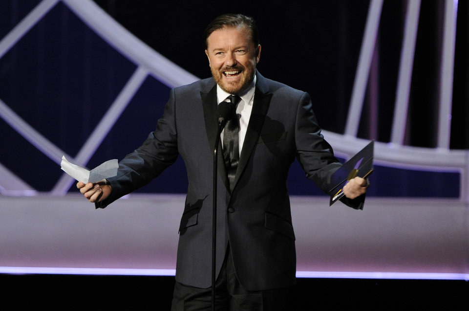 Photo - Ricky Gervais presents the award for outstanding writing for a variety, music or comedy special on stage at the 66th Annual Primetime Emmy Awards at the Nokia Theatre L.A. Live on Monday, Aug. 25, 2014, in Los Angeles. (Photo by Chris Pizzello/Invision/AP)