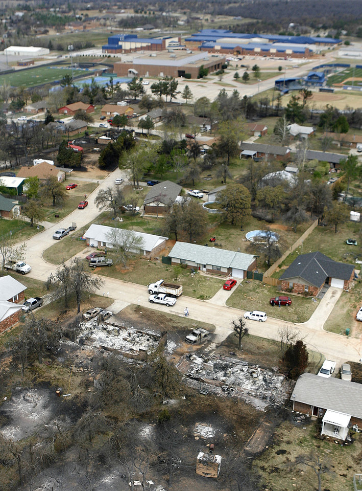 Fire destroyed a number of homes in this neighborhood near Choctaw High School in Choctaw, OK, Friday, April 10, 2009. Photo by Paul Hellstern