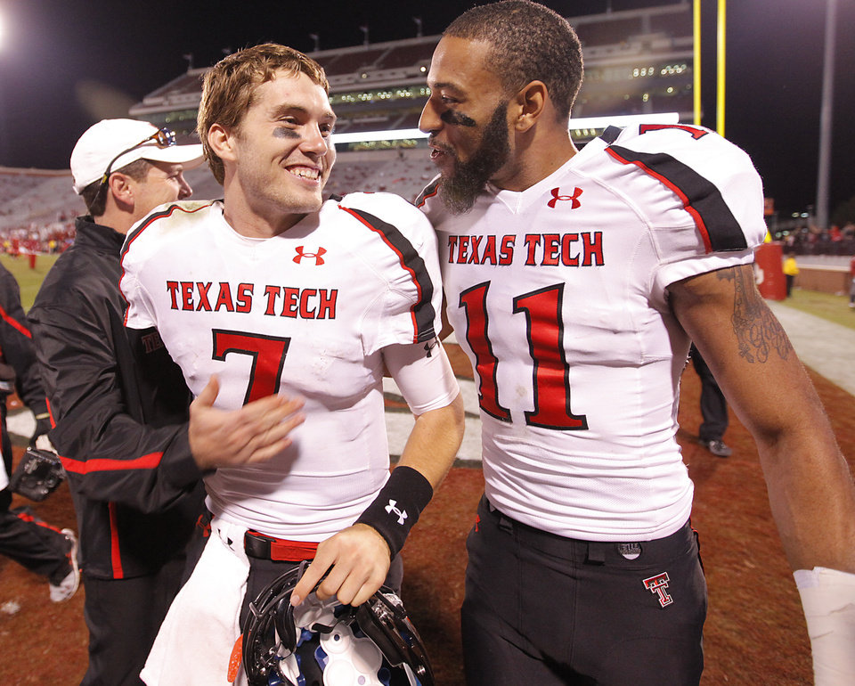 Photo - Texas Tech's Seth Doege (7) and Tramain Swindall (11) celebrate after defeating Oklahoma 41-38 during the college football game between the University of Oklahoma Sooners (OU) and Texas Tech University Red Raiders (TTU) at the Gaylord Family-Oklahoma Memorial Stadium on Sunday, Oct. 23, 2011. in Norman, Okla. Photo by Chris Landsberger, The Oklahoman