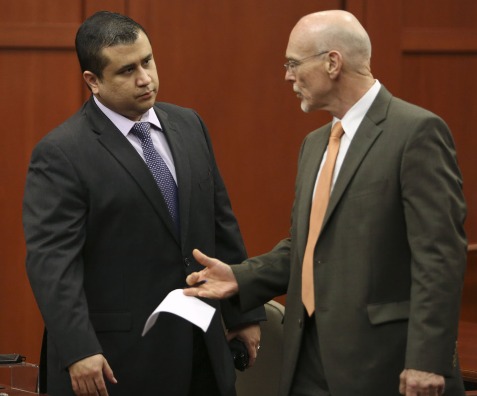 George Zimmerman, left, talks to his attorney, Don West, during jury deliberations in his trial in Sanford, Fla., Saturday, July 13, 2013. Zimmerman has been charged with second-degree murder for the 2012 shooting death of Trayvon Martin. (AP Photo/Orlando Sentinel, Gary W. Green, Pool) ORG XMIT: FLJR228