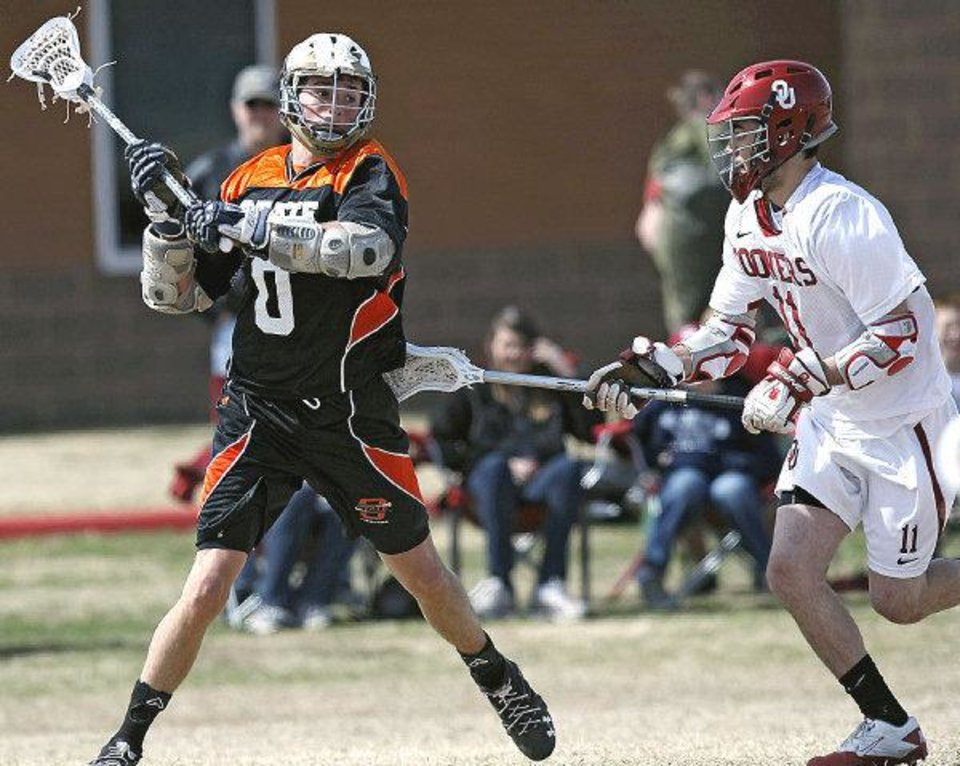 OSU's Ryan Pence passes to an open teammate despite pressure from OU's  Cameron Stackhouse. OU won Sunday's Bedlam game in Edmond 15-1. PHOTO BY JOHN CLANTON, THE OKLAHOMAN <strong>John Clanton</strong>