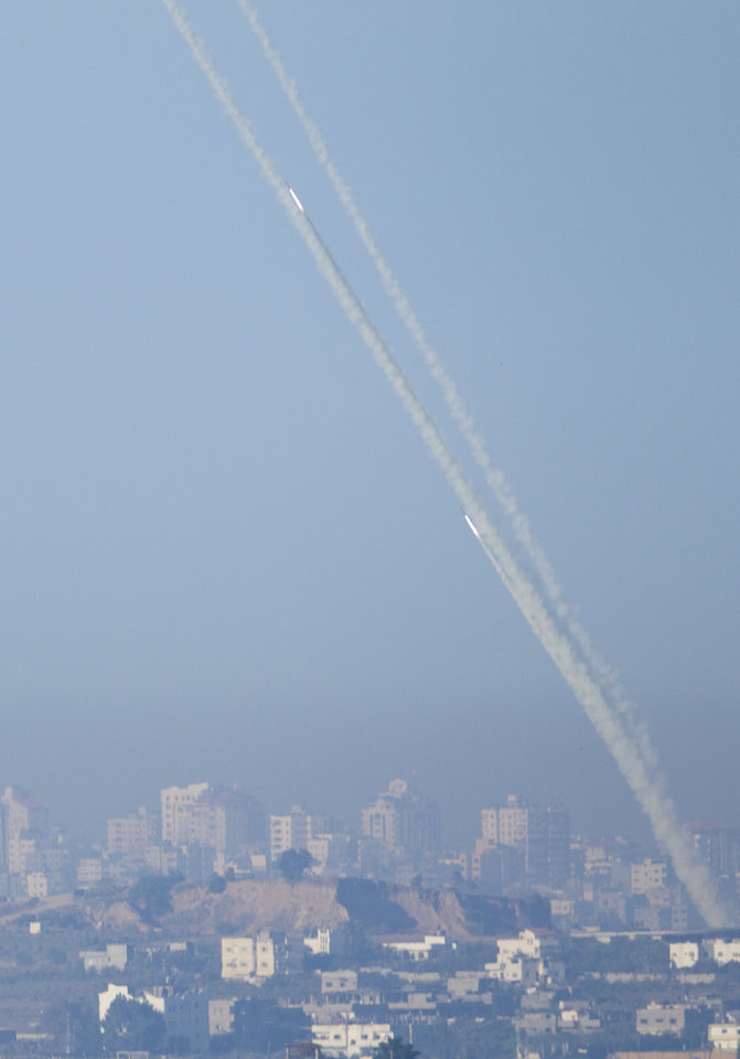 Rockets launched by Palestinians militants towards Israel make their way from the northern Gaza Strip, seen from the Israel Gaza Border, southern Israel, Thursday, Nov. 15, 2012. (AP Photo/Ariel Schalit)