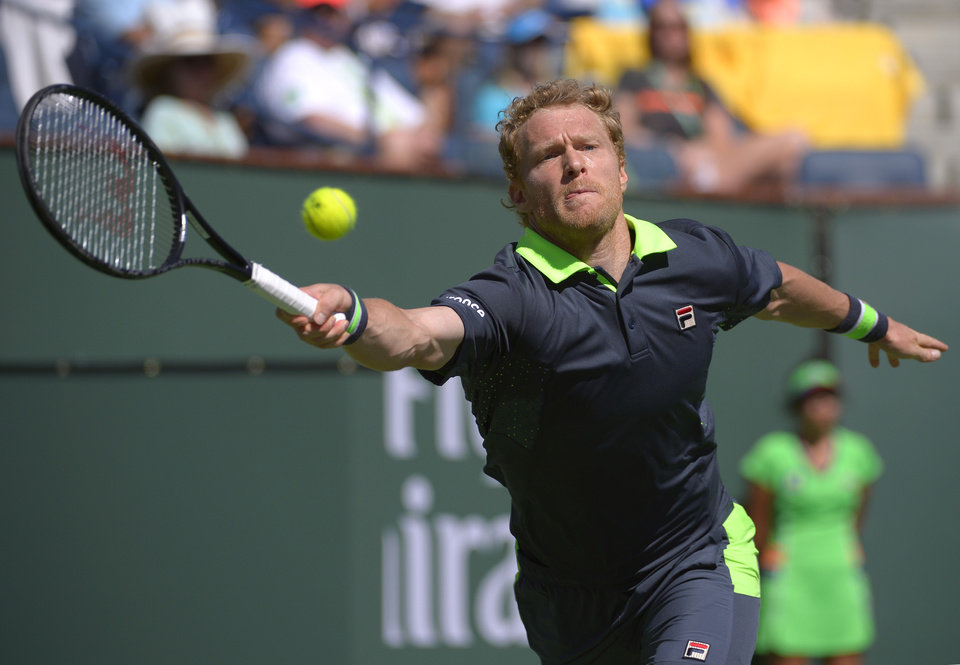 Photo - Dmitry Tursunov, of Russia, hits to Roger Federer, of Switzerland, during a third round match at the BNP Paribas Open tennis tournament, Monday, March 10, 2014, in Indian Wells, Calif. (AP Photo/Mark J. Terrill)