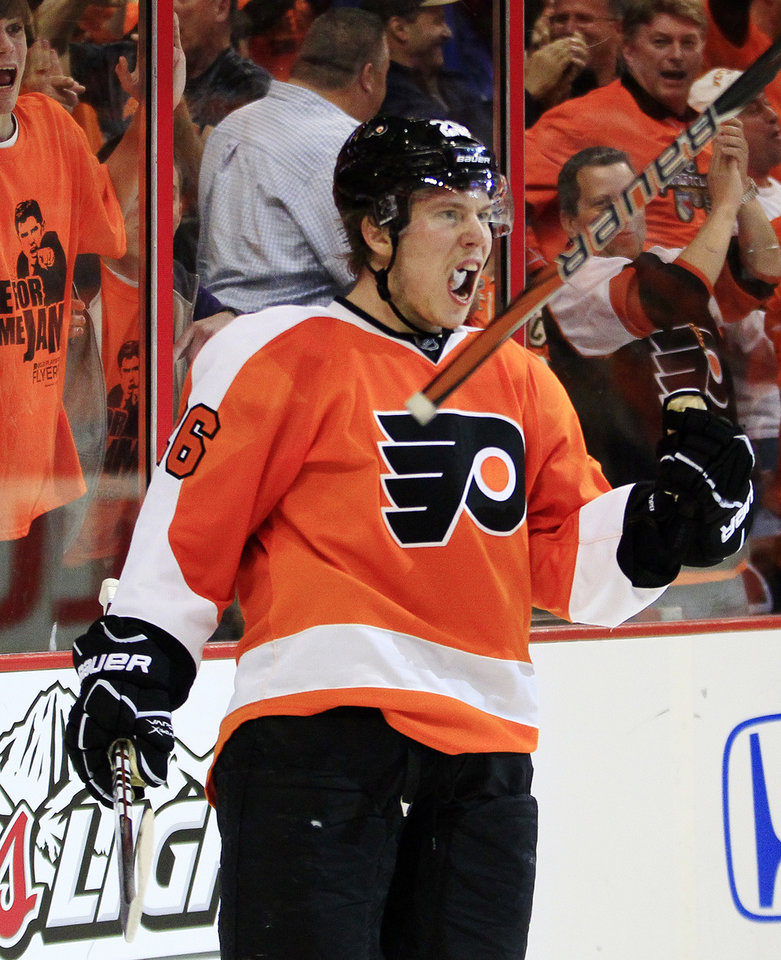 Photo -   Philadelphia Flyers' Erik Gustafsson exults after scoring a break-away goal against Pittsburgh Penguins goalie Marc-Andre Fleury during the second period in Game 6 of an NHL hockey Stanley Cup first-round playoff series, Sunday, April 22, 2012, in Philadelphia. (AP Photo/Tom Mihalek)