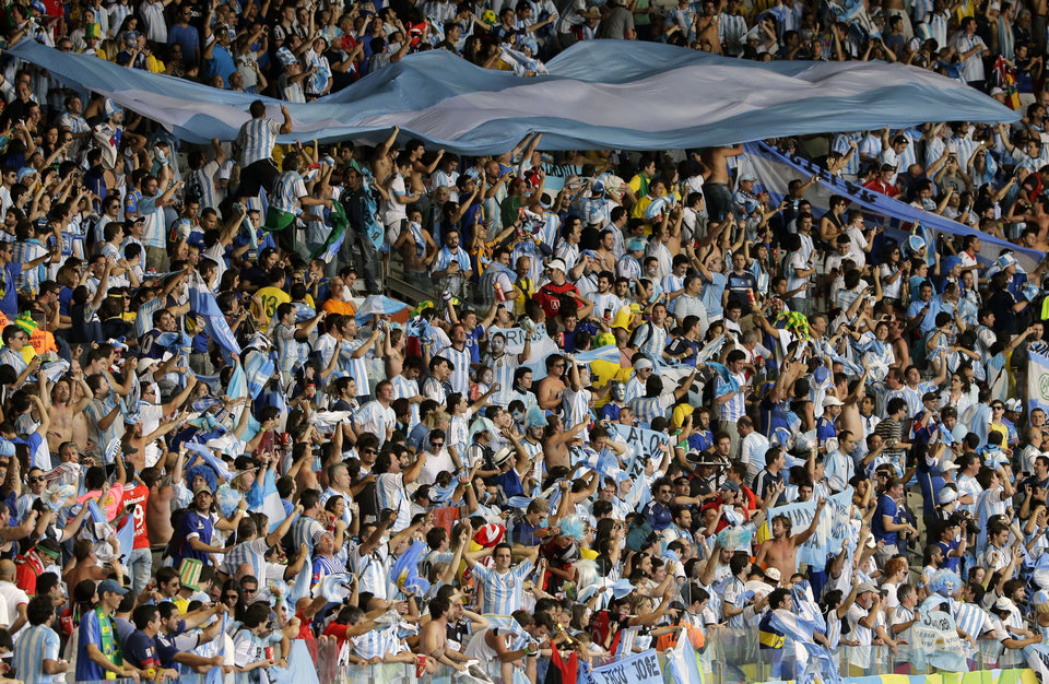 Photo - Argentina's fans celebrate after the group F World Cup soccer match between Argentina and Iran at the Mineirao Stadium in Belo Horizonte, Brazil, Saturday, June 21, 2014. Lionel Messi scored a superb goal in stoppage time to give Argentina a 1-0 victory over Iran.(AP Photo/Sergei Grits)