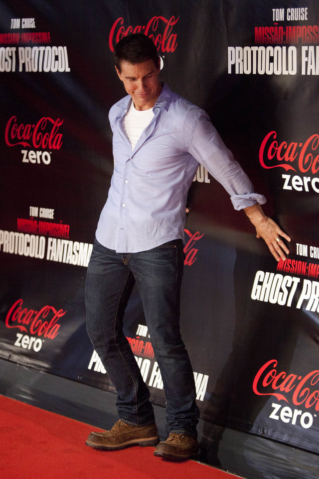 U.S actor Tom Cruise tumbles as he arrives on the red carpet for the Premiere of Mission Impossible Ghost Protocol in Rio de Janeiro, Brazil, Wednesday Dec.  14, 2011. (AP Photo/Felipe Dana) ORG XMIT: XFD`07