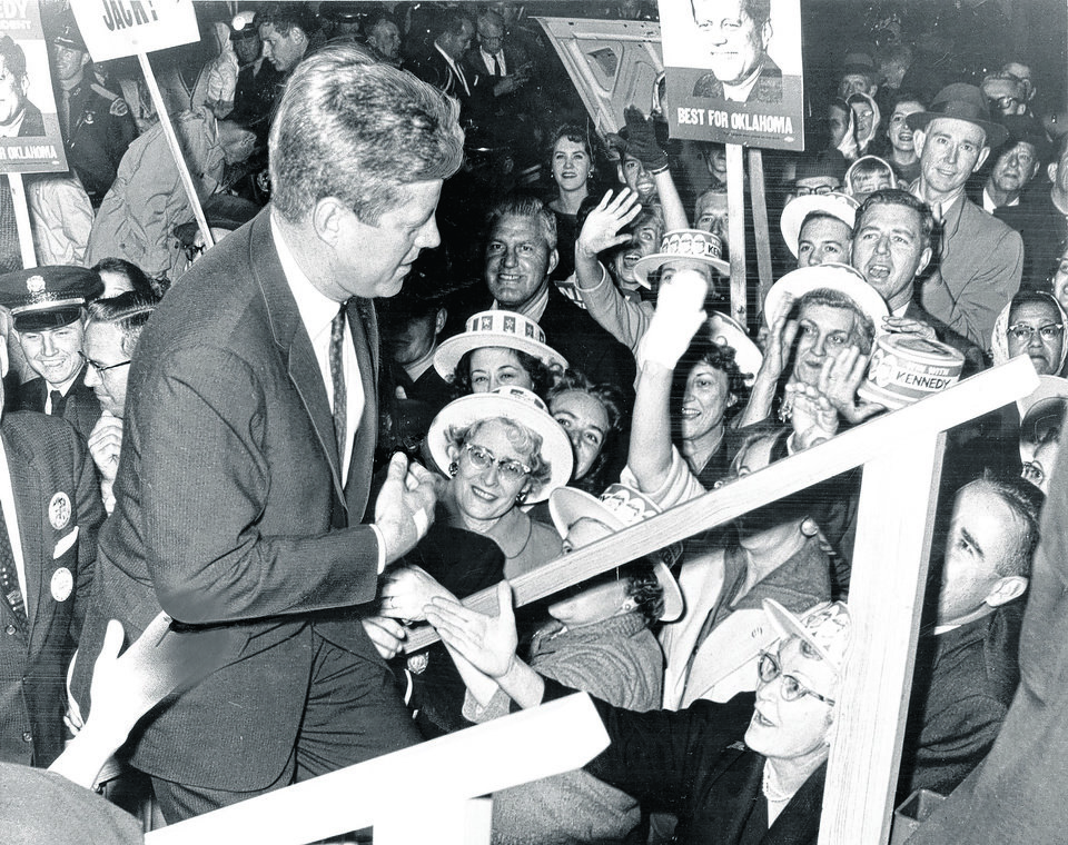 Photo - STATE, OKLAHOMA, VISITS: IMMEDIATELY BEFORE his election in November, 1960, President (John F.) Kennedy is shown approaching the stage at Will Rogers Field during a whilrwind, last-minute visit to Oklahoma City on Thursday, 11/3/60, to attend a campaign rally in the Municipal Auditorium. Staff photo by Richard