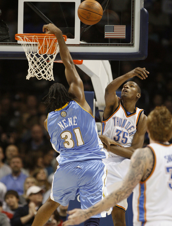 Photo - Kevin Durant blocks a shot by Nene in the first half as the Oklahoma City Thunder play the Denver Nuggets at the Ford Center in Oklahoma City, Okla. on Friday, January 2, 2009.  Photo by Steve Sisney/The Oklahoman