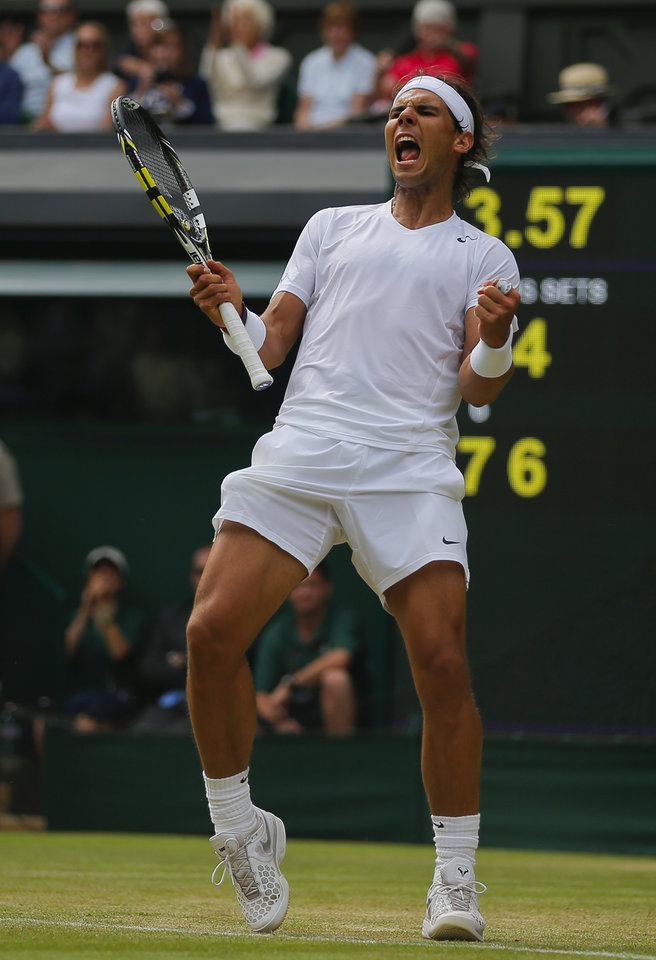 Photo - Rafael Nadal of Spain celebrates as he defeated Lukas Rosol of Czech Republic in their men's singles match on Centre Court at the All England Lawn Tennis Championships in Wimbledon, London, Thursday, June 26, 2014. (AP Photo/Pavel Golovkin)