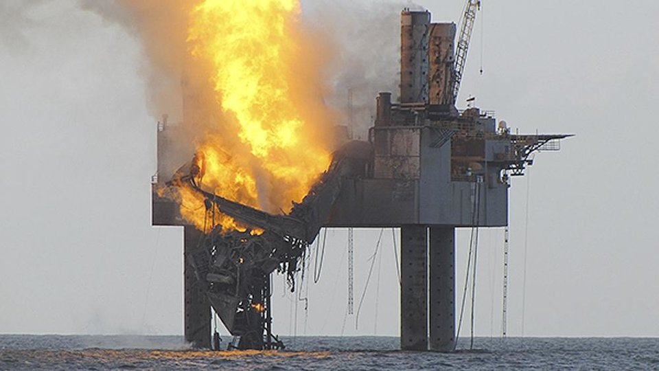 Photo - In this Wednesday, July 24, 2013 photo released by the U.S. Coast Guard, abatement efforts underway near Hercules 265 Rig where fire has caused collapse of the drill floor and derrick following an explosion Tuesday night. An out-of-control natural gas well burned Wednesday off Louisiana hours after it ignited following a blowout, though authorities said there was no sign of a slick on the surface of the water. (AP Photo/U.S. Coast Guard)