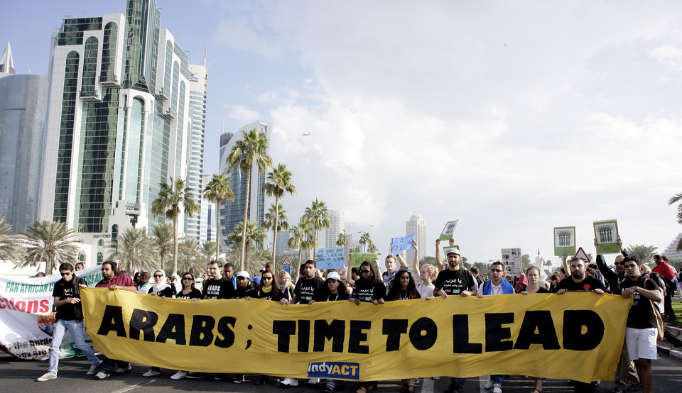Photo - Local and international activists march to demand urgent action to address climate change at the U.N. climate talks in Doha, Qatar, Saturday , Dec. 1, 2012. (AP Photo/Osama Faisal)