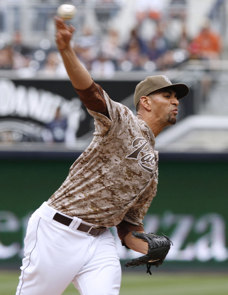 Photo - San Diego Padress starting pitcher Tyson Ross pitches in the first inning of a baseball game against the Detroit Tigers Sunday, April 13, 2014, in San Diego. (AP Photo/Don Boomer)