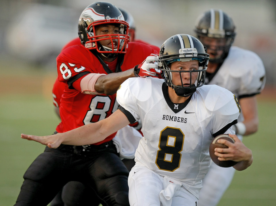 Midwest City's Joel Davis runs past Del City's Steffon Herd during a high school football game in Del City, Okla., Friday, September 2, 2011. Photo by Bryan Terry, The Oklahoman