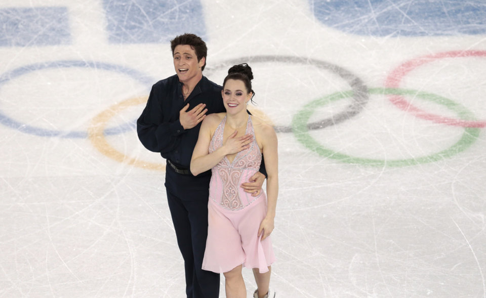 Photo - Tessa Virtue and Scott Moir of Canada complete their routine in the ice dance free dance figure skating finals at the Iceberg Skating Palace during the 2014 Winter Olympics, Monday, Feb. 17, 2014, in Sochi, Russia. (AP Photo/Ivan Sekretarev)