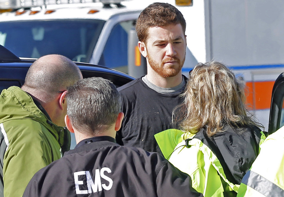 Photo - EMS personnel speak with Cody Cousins, 23, who was detained after a shooting inside the Electrical Engineering building on the campus of Purdue University in West Lafayette, Ind. Cousins, of Warsaw, Ind., is being held in the Tippecanoe County Jail on a preliminary charge of murder, accused of shooting 21-year-old Andrew Boldt of West Bend, Wis. (AP Photo/The Journal & Courier, John Terhune) MANDATORY CREDIT; NO SALES