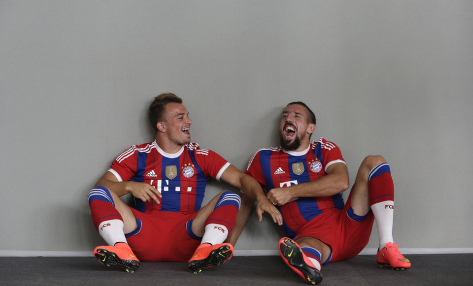 Photo - Bayern Munich's Xherdan Shaqiri, left, and Franck Ribery joke during an official photo shoot for the new German first division Bundesliga season in Munich, southern Germany, Saturday, Aug. 9, 2014. (AP Photo/Matthias Schrader)
