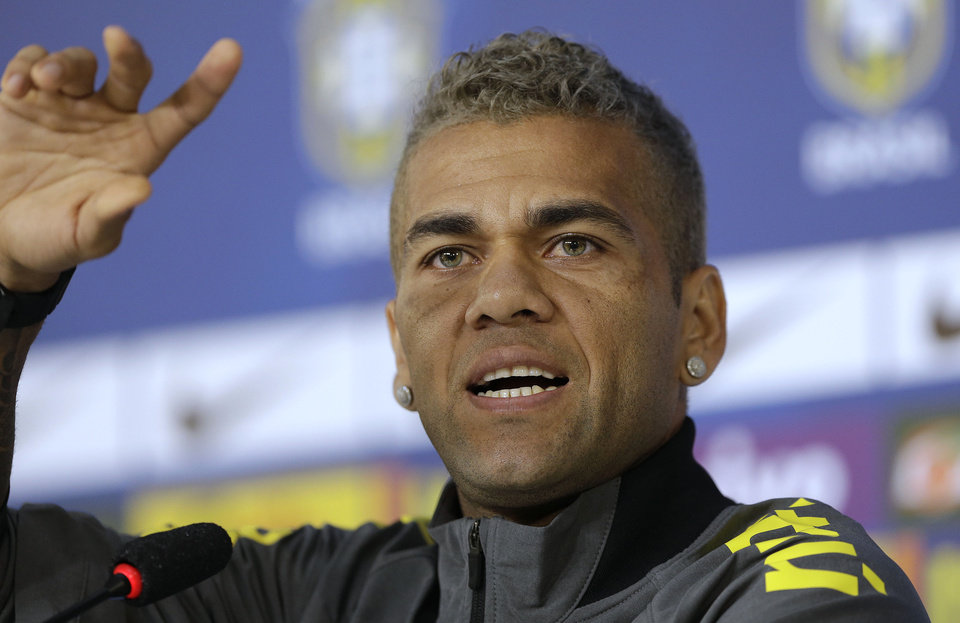 Photo - Brazil's Dani Alves gestures during a news conference at the Granja Comary training center in Teresopolis, Brazil, Saturday, June 21, 2014. Brazil plays in group A at the 2014 soccer World Cup. (AP Photo/Andre Penner)
