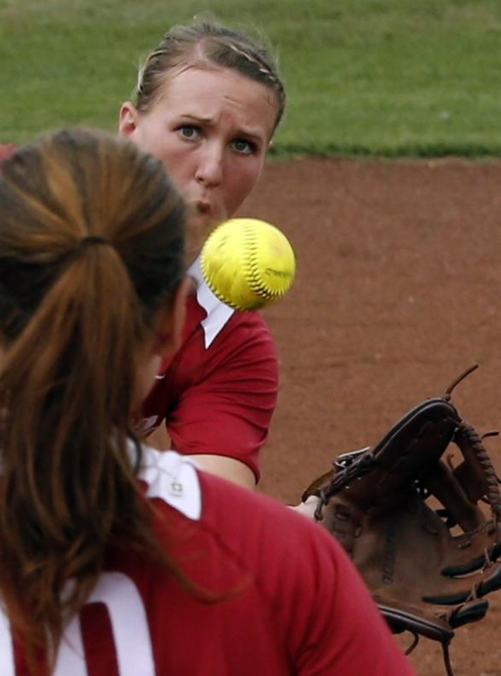 Third baseman Shelby Pendley makes a catch near the pitcher in the NCAA Super Regional softball game as the University of Oklahoma (OU) Sooners defeat Texas A&M 8-0 at Marita Hines Field on Saturday, May 25, 2013 in Norman, Okla. to advance to the College World Series.  Photo by Steve Sisney, The Oklahoman