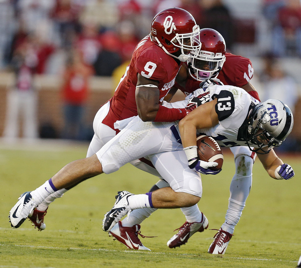 Oklahoma\'s Gabe Lynn (9) and Aaron Colvin (14) bring down TCU \'s Ty Slanina (13) during the college football game between the University of Oklahoma Sooners (OU) and the Texas Christian University Horned Frogs (TCU) at the Gaylord Family-Oklahoma Memorial Stadium on Saturday, Oct. 5, 2013 in Norman, Okla. Photo by Chris Landsberger, The Oklahoman