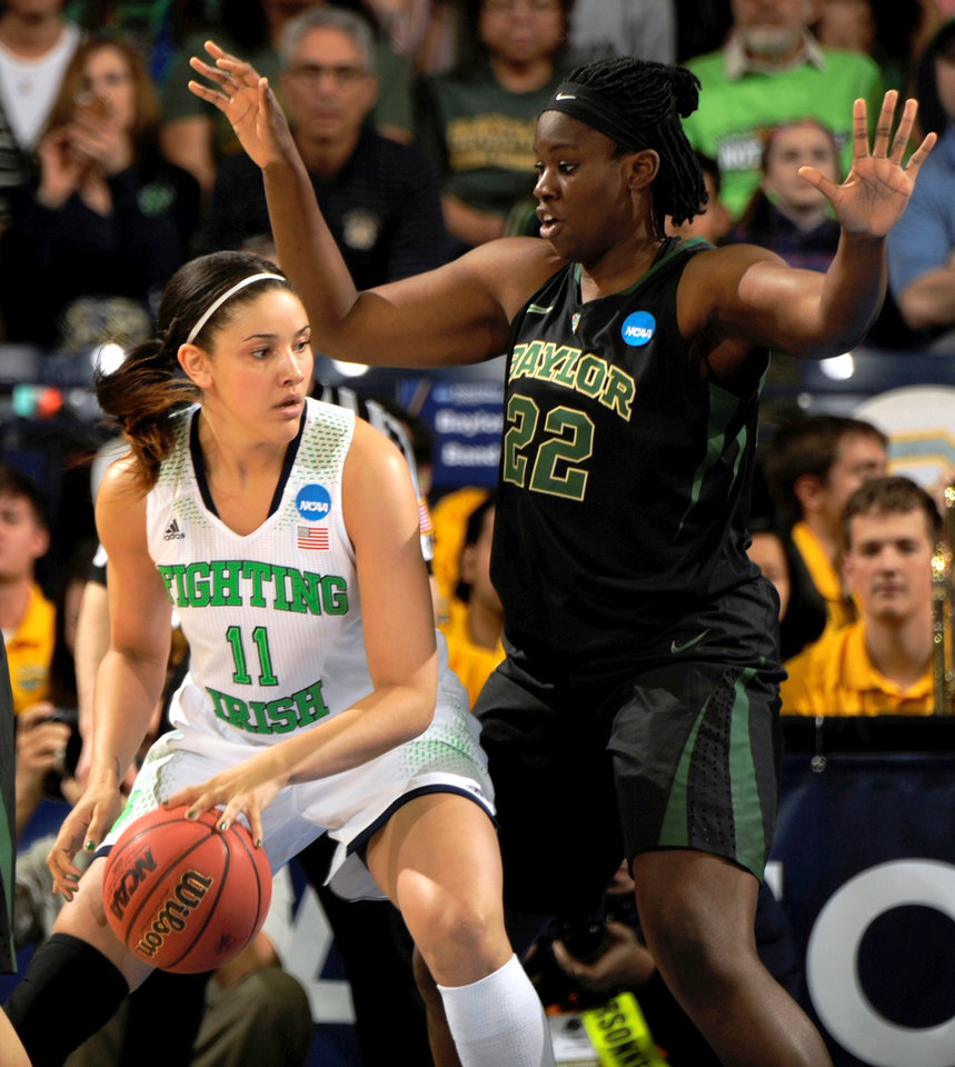 Photo - Notre Dame forward Natalie Achonwa drives the lane as Baylor center Sune Agbuke defends in the first half of their NCAA women's college basketball tournament regional final game at the Purcell Pavilion in South Bend, Ind., Monday March 31, 2014. (AP Photo/Joe Raymond)