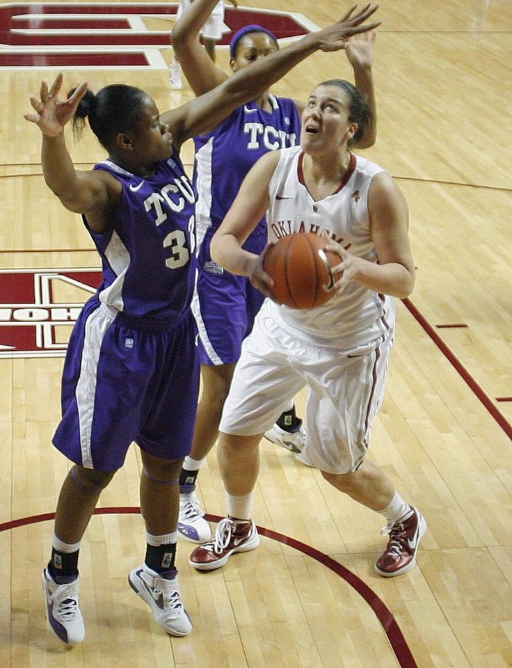 Oklahoma Sooners\' Jelena Cerina (12) shoots betwen TCU Horned Frogs\' Briesha Wynn (left) and Ashley Colbert (back) as the University of Oklahoma (OU) Sooners play the Texas Christian University (TCU) Horned Frogs in women\'s college basketball at the Lloyd Noble Center on Wednesday, Dec. 28, 2011, in Norman, Okla. Photo by Steve Sisney, The Oklahoman