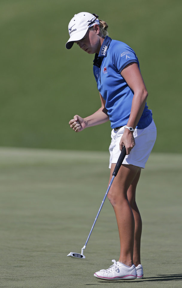 Photo -   Stacy Lewis reacts after saving a par on the 11th hole during final round play in the Navistar LPGA Classic golf tournament, Sunday, Sept. 23, 2012, at the Robert Trent Jones Golf Trail in Prattville, Ala. (AP Photo/Dave Martin)