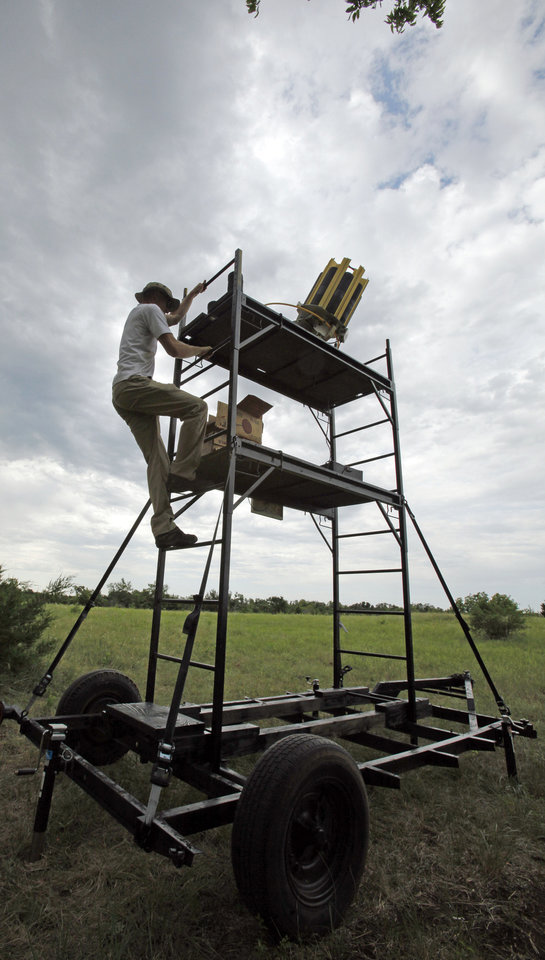 Photo - Joseph Burkhart reloads an elevated trap machine at the Oklahoma Sporting Clays State Championships being held at Quail Ridge Sporting Clays on Friday, June 1, 2012, in Oklahoma City, Okla.  Photo by Steve Sisney, The Oklahoman