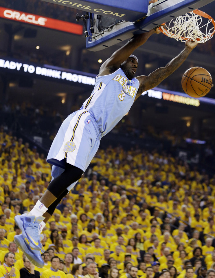 Photo - Denver Nuggets' Ty Lawson dunks against the Golden State Warriors during the first half of Game 4 in a first-round NBA basketball playoff series, Sunday, April 28, 2013, in Oakland, Calif. (AP Photo/Ben Margot)