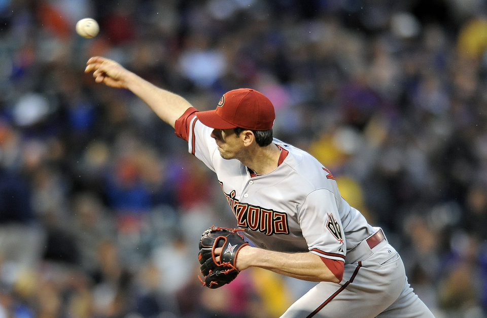 Photo - Arizona Diamondbacks starting pitcher Brandon McCarthy throws in the first inning of a baseball game against the Colorado Rockies on Saturday, April 5, 2014, in Denver. (AP Photo/Chris Schneider)