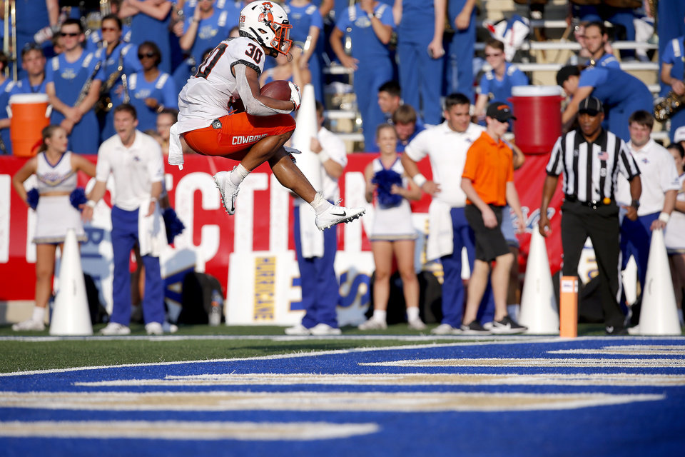 Photo - Oklahoma State's Chuba Hubbard (30) leaps into the end zone as he scores a touchdown in the fourth quarter during a college football game between the Oklahoma State University Cowboys (OSU) and the University of Tulsa Golden Hurricane (TU) at H.A. Chapman Stadium in Tulsa, Okla., Saturday, Sept. 14, 2019. [Sarah Phipps/The Oklahoman]