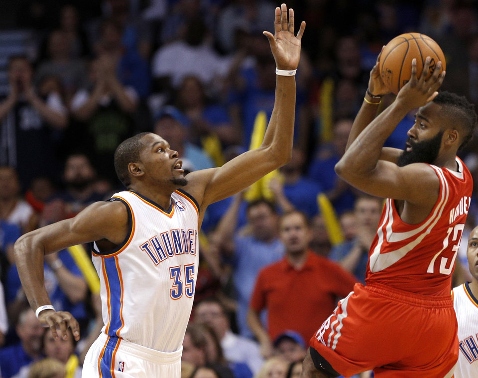 Photo - Oklahoma City's Kevin Durant (35) defends against Houston's James Harden (13) during the NBA game between the Oklahoma City Thunder and Houston Rockets at the  Chesapeake Energy Arena  in Oklahoma City, Okla., Tuesday, March 11, 2014. Photo by Sarah Phipps, The Oklahoman