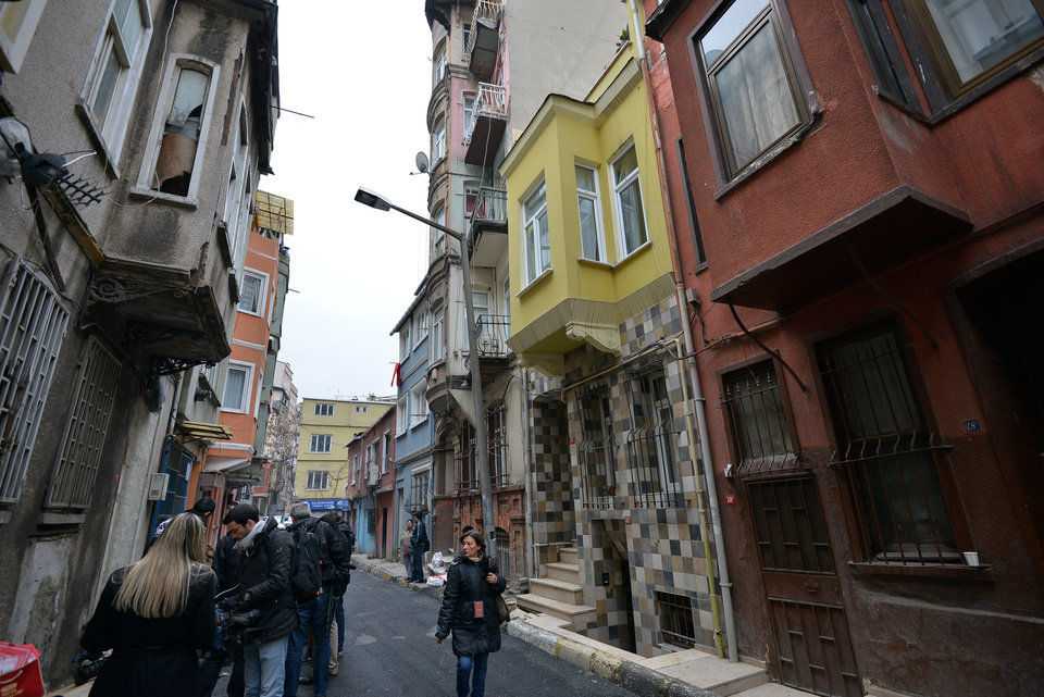 Photo - A view of the street with the hostel, in yellow, where Sarai Sierra, a New York City woman, 33, was staying in Istanbul, Turkey, Monday, Jan. 28, 2013. Police in Istanbul were scanning security camera footage Monday to try to trace  Sierra who went missing while vacationing alone in the city, a Turkish official said. A police official said authorities were reviewing footage from around Istanbul's Taksim neighborhood _ the city's main hub where she was staying at a hostel.(AP Photo)