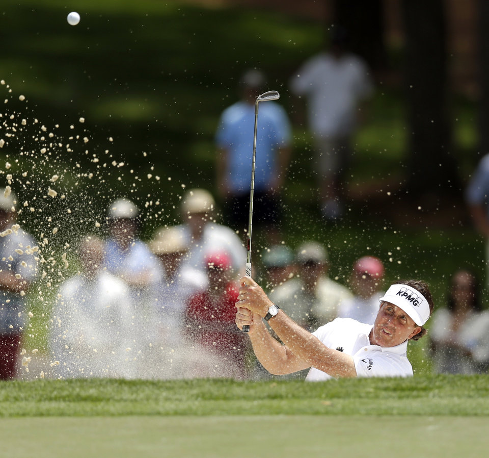 Photo - Phil Mickelson hits from a sand trap on the fourth hole during the first round of the Wells Fargo Championship golf tournament in Charlotte, N.C., Thursday, May 1, 2014. (AP Photo/Chuck Burton)