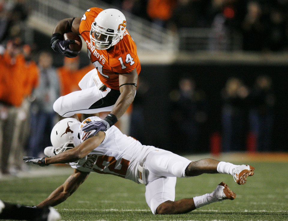 Photo - Justin Horton (14) of OSU is upended by Earl Thiomas (12) of Texas during the college football game between the Oklahoma State University Cowboys (OSU) and the University of Texas Longhorns (UT) at Boone Pickens Stadium in Stillwater, Okla., Saturday, Oct. 31, 2009. Photo by Sarah Phipps, The Oklahoman