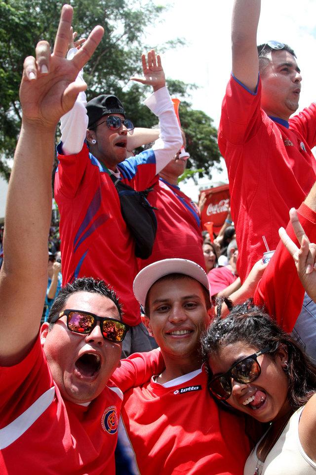 Photo - Costa Rica soccer fans celebrate after their team's World Cup victory over Italy in San Jose, Costa Rica, Friday, June 20, 2014. Costa Rica won 1-0. (AP Photo/Enrique Martinez)