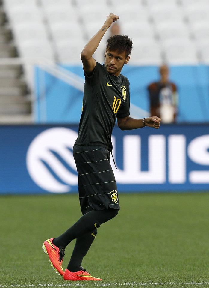 Photo - Brazil's Neymar gestures during an official training session the day before the group A World Cup soccer match between Brazil and Croatia in the Itaquerao Stadium in Sao Paulo, Brazil, Wednesday, June 11, 2014. (AP Photo/Kirsty Wigglesworth)