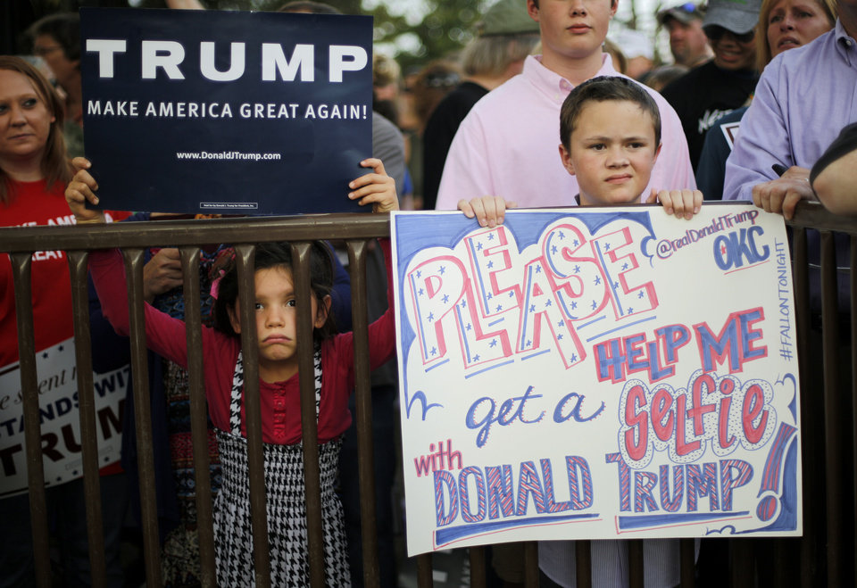 Photo - Quaid Morgan, 12, of Oklahoma City, at right, waits for Republican presidential candidate Donald Trump before a rally at the Oklahoma State Fair in Oklahoma City, Friday, September 25, 2015. Photo by Bryan Terry, The Oklahoman