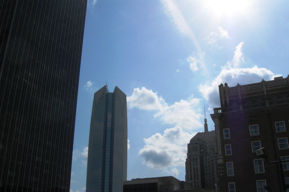 Photo - The four major eras of downtown skyscraper development - 1910 to 1911 (Skirvin Hilton Hotel), the early 1930s (First National Center), the 1970s (Chase Tower) and current day (Devon Energy Center) - are shown in this photo taken Thursday.  Steve Lackmeyer