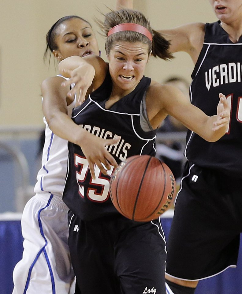 Millwood's Teanna Reid (10) and Verdigris' Baileigh O'Dell (25) battle for the ball during the 3A girls quarterfinals game between Millwood High School and Verdigris High School at the State Fair Arena on Thursday, March 7, 2013, in Oklahoma City, Okla. Photo by Chris Landsberger, The Oklahoman