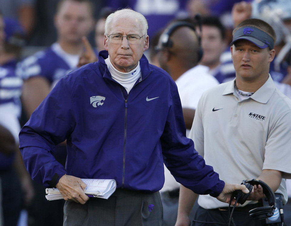 Kansas State coach Bill Snyder takes off his headset to check on an injured player during the second half of an NCAA college football game against Baylor in Manhattan, Kan., Saturday, Oct. 12, 2013. Baylor defeated Kansas State 35-25. (AP Photo/Orlin Wagner)