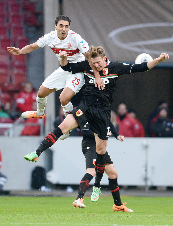 Photo - Stuttgart's  Mohammed Abdellaoe. left, challenges for the ball with Augsburg's Jan Callsen-Bracker  during the German first division soccer match between VfB Stuttgart and FC Augsburg, in Stuttgart, southern Germany, Sunday Feb. 9, 2014.  (AP Photo/dpa,Bernd Weißbrod)
