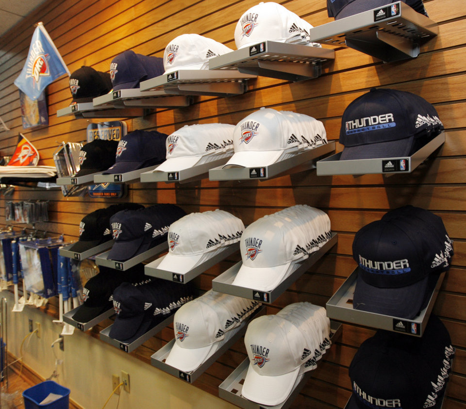 Photo - A display of hats in the team store after the unveiling of the Oklahoma City Thunder NBA team name at Leadership Square in downtown Oklahoma City, Wednesday, September 3, 2008. NATE BILLINGS, THE OKLAHOMAN