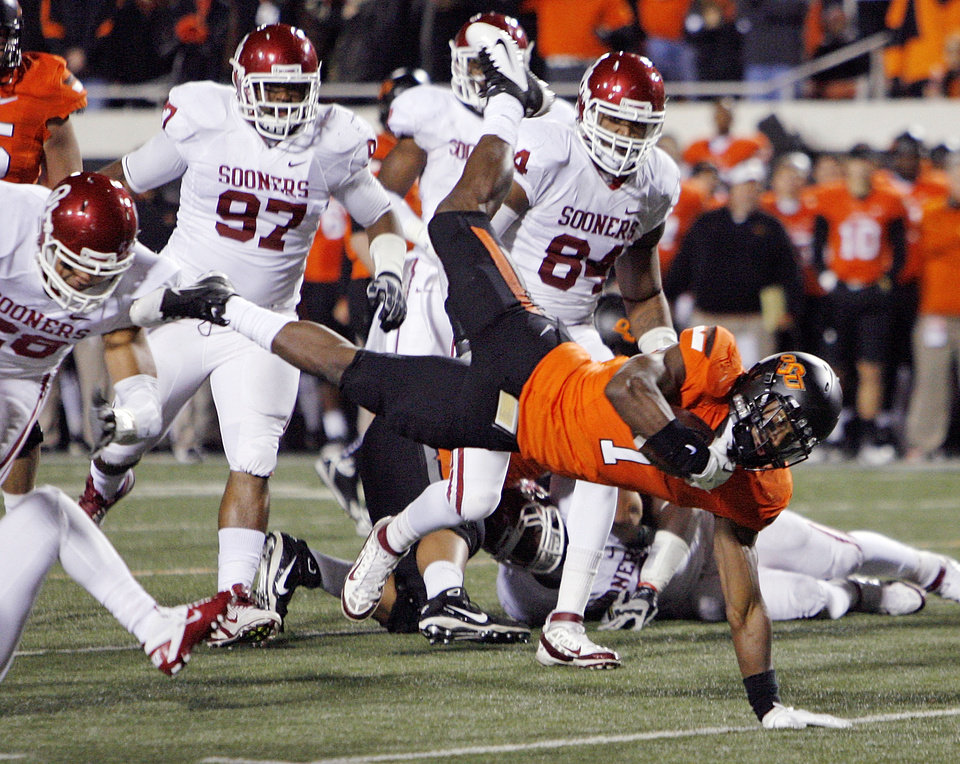 Photo - OSU's Joseph Randle (1) supports himself at the end of a play in the first quarter during the Bedlam college football game between the Oklahoma State University Cowboys (OSU) and the University of Oklahoma Sooners (OU) at Boone Pickens Stadium in Stillwater, Okla., Saturday, Dec. 3, 2011. Photo by Nate Billings, The Oklahoman