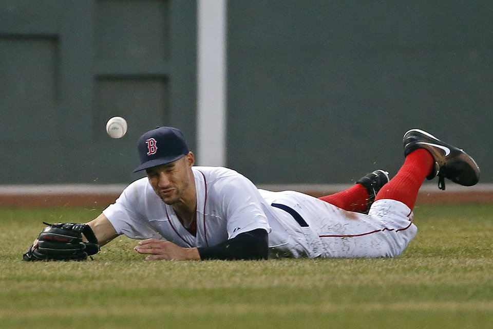 Photo - Boston Red Sox center fielder Grady Sizemore dives but cannot come up with an RBI double by Texas Rangers' Donnie Murphy in the third inning of a baseball game at Fenway Park in Boston, Tuesday, April 8, 2014. (AP Photo/Elise Amendola)