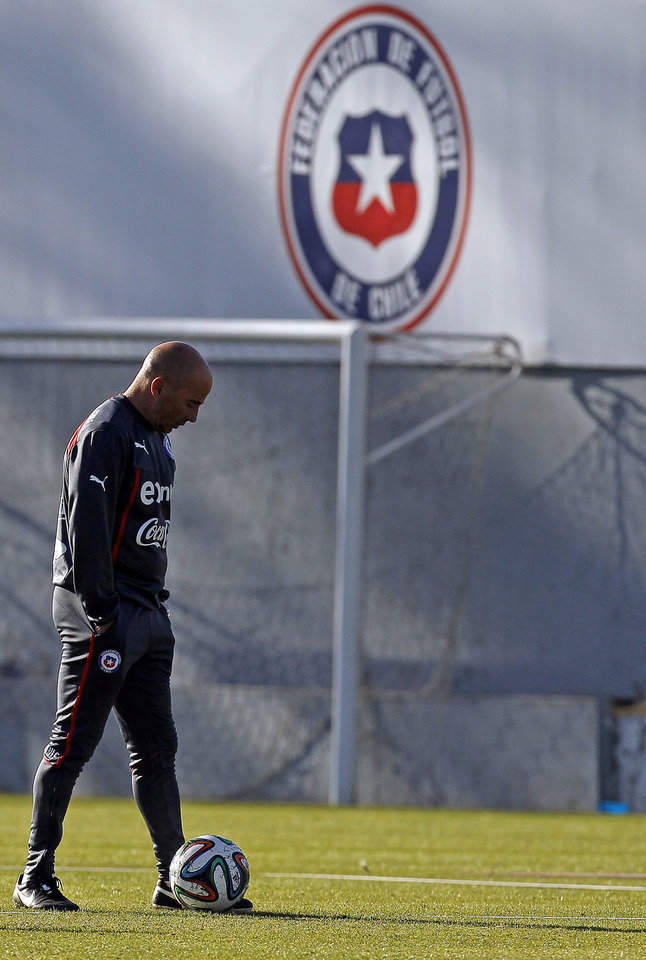 Photo - Chile's coach Jorge Sampaoli walks on the field during a training session in Santiago, Chile, Wednesday, May 28, 2014. Chile will play a friendly match with Egypt in Santiago on Friday prior to competing at the World Cup in Brazil in June.  (AP Photo/Luis Hidalgo)