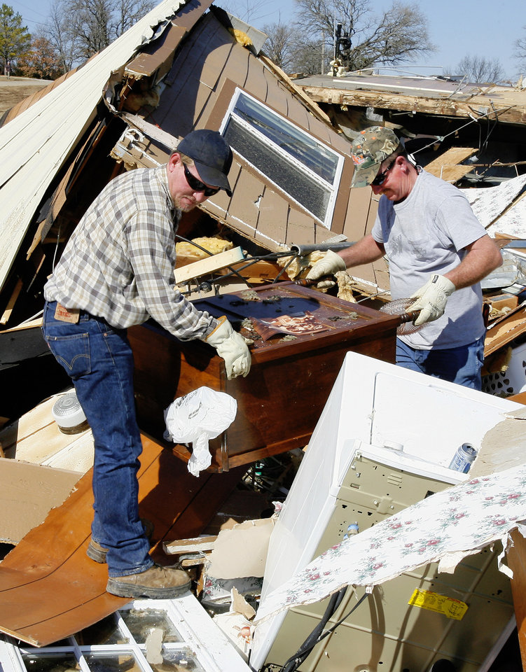 Roger Jones, right, gets help searching the debris of his mobile home from his nephew Josh Jones, left, on Newport Road in Lone Grove Wednesday, Feb. 11, 2009. BY PAUL B. SOUTHERLAND, THE OKLAHOMAN