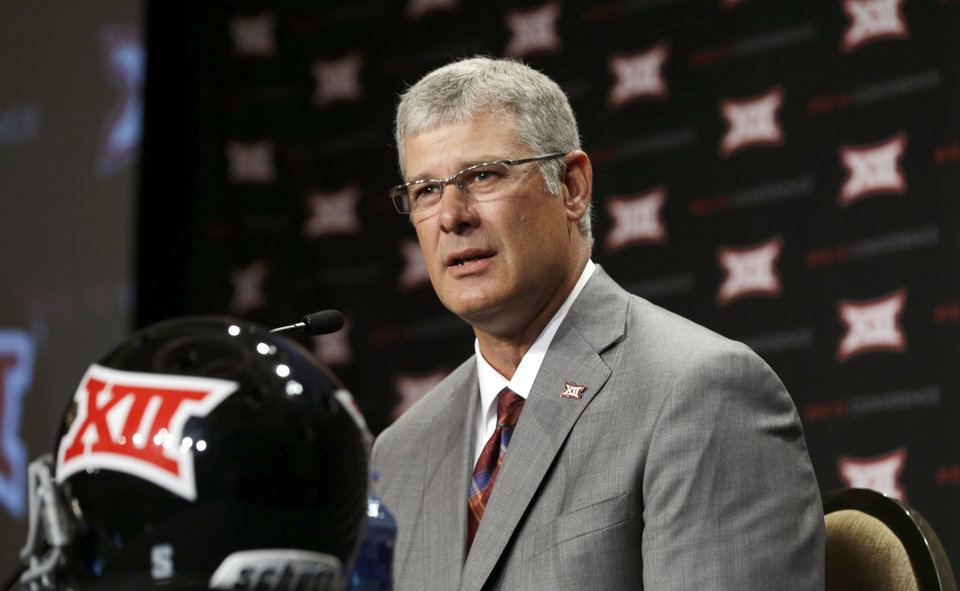 Photo - Iowa State head coach Paul Rhodes answers a reporter's question at the Big 12 Conference NCAA college football media days in Dallas, Tuesday, July 22, 2014. (AP Photo)