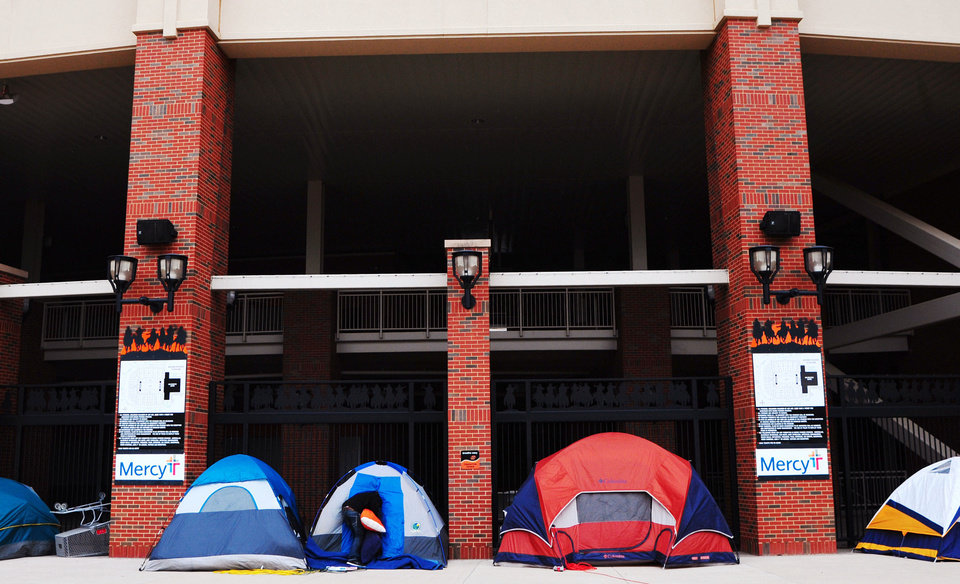 Photo - Students in tents crowd the outside Boone Pickens Stadium in Stillwater this week before university officials ended the gathering. Students were camping out in frigid weather for good seats for Saturday's football game between the University of Oklahoma and Oklahoma State University. Photo by KT King/For the Oklahoman  KT King