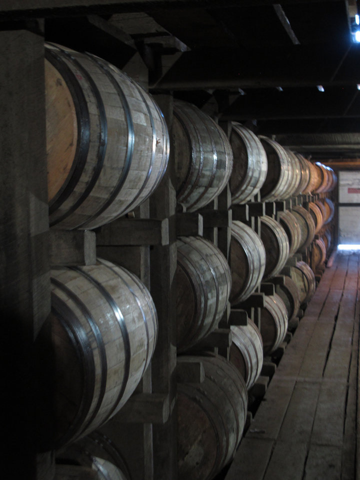 Photo - In a July 24, 2014 photo, bourbon supplies age in barrels at the Jim Beam distillery in Clermont, Ky. Kentucky bourbon makers have stashed away their largest stockpiles in more than a generation due to resurgent demand for the venerable brown spirit. (AP Photo/Bruce Schreiner)